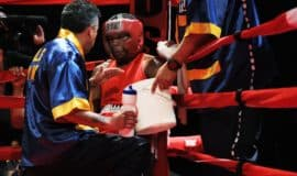 boxer in his corner getting feedback from his coach