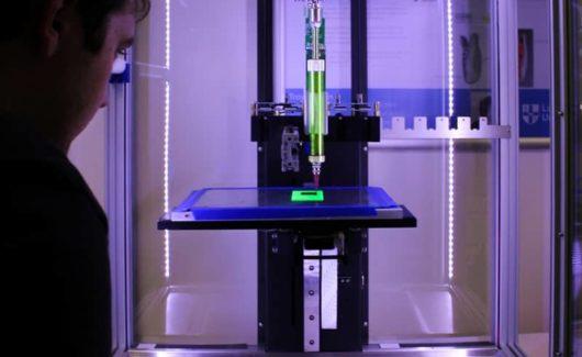person near 3-D printer machine