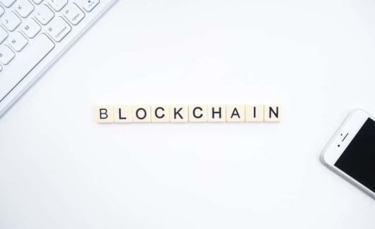 "scrabble tiles spelling ""blockchain"""
